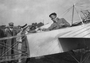 "Alfred Leblanc in airplane, being congratulated by Henri Deutsch de la Muerthe, at Nancy after ""Circuit de l'Est d'Aviation"" in France.  Source:  Library of Congress"