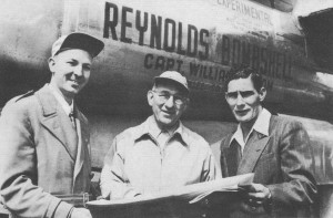 Capt. Bill Odom, pilot (L), Milton Reynolds, navigator (center), and Carroll Sallee, flight engineer (R) standing in front of the Reynolds Bombshell during the round-the-world tour.  Source:  contemporary press photo, photographer unknown.
