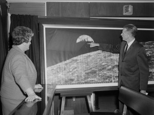 "NASA Langley Center Director Floyd Thompson shows Ann Kilgore the ""picture of the century."" Image Credit:  NASA"