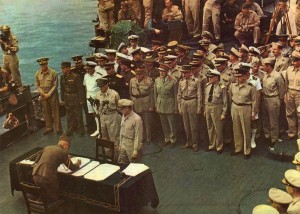 Japanese General Yoshijirou Umezu, Chief of the Army General Staff, signs the surrender documents on board the USS Missouri.