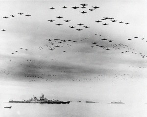 Waves of US Navy aircraft fly over Tokyo Bay to celebrate the signing of Japan's surrender at the end of World War II.  USS Missouri (BB-63), where the ceremonies took place, is at left. USS Detroit (CL-8) is in the right distance.  Aircraft include TBM Avengers, F6F Hellcats, SB2C Helldivers and F4U Corsairs.  Photo Credit:  US Navy