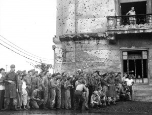 At Manila City Hall, Gen. MacArthur (on balcony at top) awaits the arrival of the Japanese delegation.  Photo Credit:  National Archives
