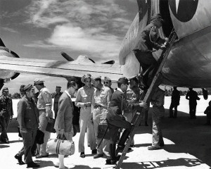 The Japanese delegation boards the C-54 transport at Ie Shima -- at top of ladder Lieutenant General Torashiro Kawabe, followed by unidentified civilian envoy, then Rear Admiral Ichiro Yokoyama.  Photo Credit:  US Navy