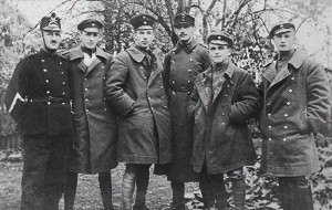 The German pilots of Kest 5 who arrived on November 13, with Swiss police (at left) and Oskar Bider, the famous Swiss pilot, at the center (tallest).  Photo Credit:  Provided by the Descendants of Fritz Beckhardt.