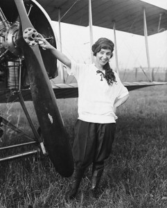 "Katherine Stinson standing in front of her Partridge & Keller biplane, sporting her daring dress style -- the conservatives of the day condemned her act as ""pants on a woman!"""