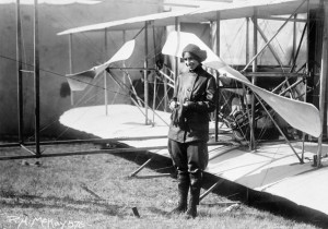Katherine Stinson before her Wright Flyer at the Montana State Fair in 1913. She flew bags of mail from the fairgrounds to drop on Helena's downtown post office, thus becoming the first person to deliver airmail in Montana. Photo Credit:  R. H. McKay, Missoula, Montana, MHS Photo Archives
