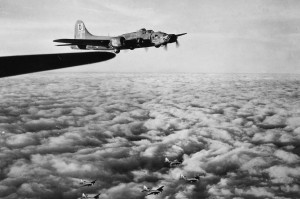 "Another B-17F ""Alice from Dallas"" (42-5867) of the 100th Bomb Group, this one with the 350th Bomb Squadron, climbing out after take off heading to bomb Warnemunde in July 1943."