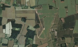 A satellite image of Thorpe Abbotts airfield today, the bare outlines and overgrown runways of the old base still visible more than 70 years after the end of the war.  Credit:  Google Earth