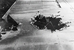 Flak damaged sustained on the mission to Münster, this on the left wing of a B-17 from the 390th BG(H), which had landed at Thorpe Abbotts after the mission on October 10, 1943, due to weather.  Credit:  100th Bomb Group Archives