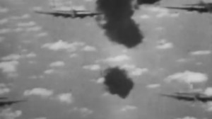 B-17s flying through the black bursts of German flak, as seen from gun camera footage taken from an attacking German plane.