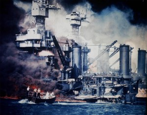 USS West Virginia in the aftermath of the attack, as survivors struggle on the deck of the ship.