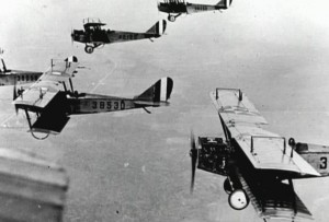Curtiss Jenny biplane trainers flying in formation; these very planes, flying out of Kelly field, Texas, would later be made surplus and sold to the general public; perhaps some of these very planes shown participated in the bombing of Tulsa.  Photo Credit:  US Army Air Service