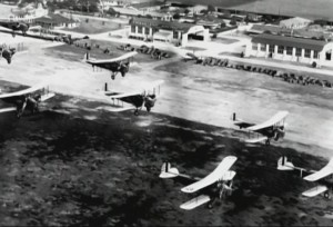 Curtiss JN-4 Jenny biplane trainers flying in formation from Kelly field, Texas; these would later be made surplus and sold to the general public; perhaps some of these very planes shown participated in the bombing of Tulsa. Photo Credit: US Army Air Service