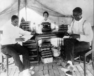 Buck Colbert Franklin, at right, the African-American lawyer who would later pave the way for the reconstruction, sits in a Red Cross tent after the riots.