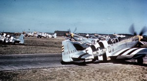 "P-51 Mustangs, including (E9-S, serial number 42-106707) nicknamed ""Sleepytime Gal"", (B7-E, serial number 42-106839) nicknamed ""Bald Eagle III"" and (E9-K) nicknamed ""Vi"" opf the 361st Fighter Group line up for take off on D-Day at Bottisham.  Source:  Imperial War Museum, Photo #FRE 6207"