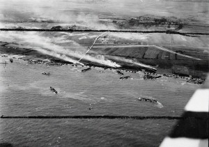 An aerial photo of the junction of King Red and King Green beaches, Gold assault area, during the landing of 50th Infantry Division, 6 June 1944. The Mont Fleury battery (WN 35a) and an anti-tank ditch are visible in front of the village of Ver-sur-Mer.  Source:  Imperial War Museum, Photo #CL3947