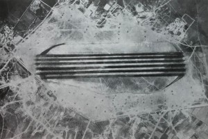 Aerial photograph of Decimomannu Air Base, Sardinia, showing the six parallel runways marked out in oil.  Photo Credit:  IMPACT Magazine, USAAF