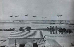 The 319th BG performs a formation landing at Decimomannu Air Base, August 1944.  Photo Credit:  IMPACT Magazine, USAAF