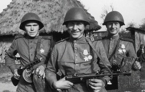 Soviet soldiers in a posed propaganda photo; the reality at the front was horrific.  Soviet soldiers were given a shot of vodka a day to help them through.